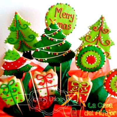 Diloconrosas.com - Pack Navidad 02 - Codigo:AFN02 - Detalles: Deliciosas galletas grandes de 5cm c/u  la decoracion es en exquisita masa elastica, cada uno viene en elegante elvoltura independiente y la presentacion es en macetero de ceramica y con decoracion navide�a Cantidad: 10 unidades - - Para mayores informes llamenos al Telf: 225-5120 o 476-0753.