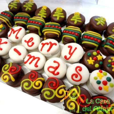 Diloconrosas.com - Pack Navidad 12 - Codigo:AFN12 - Detalles: Deliciosos alfajores grandes de 4cm c/u rellenos con exquisito manjar blanco, la decoracion es en exquisita masa elastica, cada uno viene en elegante elvoltura de aluminio y la presentacion es en caja de regalo. Cantidad: 35 unidades - - Para mayores informes llamenos al Telf: 225-5120 o 476-0753.