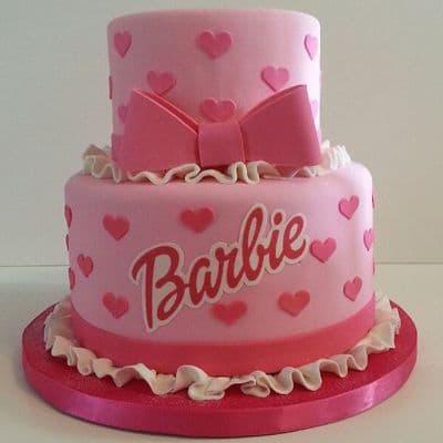 Torta Barbie 09 - Codigo:BRE09 - Detalles: Deliciosa torta de keke ingles rellena con fruta confitadas y pasa, bañada con manjar blanco y forrada con masa elastica con medidas de 1er piso de 20 cm de diametro y 2do piso de 10 cm de diamtro, logo de barbie en fotoimpresion comestible. - - Para mayores informes llamenos al Telf: 225-5120 o 4760-753.