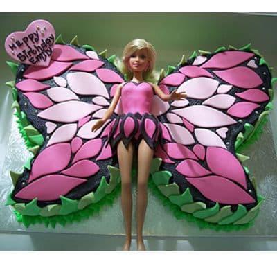 Torta Barbie 10 - Codigo:BRE10 - Detalles: Deliciosa torta de keke ingles rellena con fruta confitadas y pasa, bañada con manjar blanco y forrada con masa elastica con medidas de 20 x 30 cm modelado según la imagen, incluye barbie referencial - - Para mayores informes llamenos al Telf: 225-5120 o 4760-753.