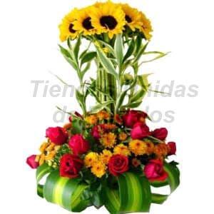 Deliregalos.com - Corporativo 02 - Codigo:CPT02 - Detalles: Hermoso topiario de 6 girasoles, 12 rosas en tono rojo, gracenia, margaritas, plantas y follajes de estaci�n, tarjeta de dedicatoria. - - Para mayores informes llamenos al Telf: 225-5120 o 476-0753.