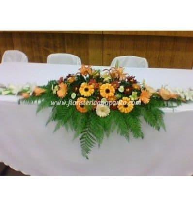 Tortas.com.pe - Deleite de flores - Codigo:AGP20 - Detalles: Arreglo Floral compuesto por base de mimbre compuesto por 5 girasoles, gerberas, iris, bot�n de oro, azucenas, flores y follaje de estaci�n.   - - Para mayores informes llamenos al Telf: 225-5120 o 476-0753.