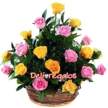 Deliregalos.com - Fiesta de Rosas - Codigo:ARL28 - Detalles: Composici�n floral en base de cesta de mimbre y 18 rosas en tonos rosados y amarillos, follaje de estaci�n.  - - Para mayores informes llamenos al Telf: 225-5120 o 476-0753.