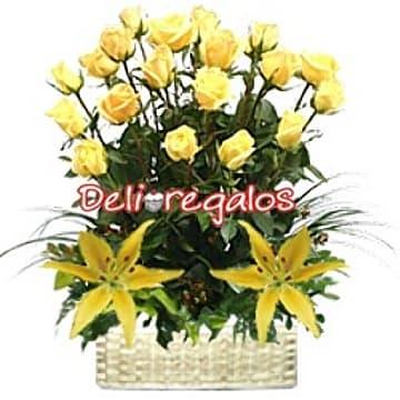 Lafrutita.com - Irradiando alegria - Codigo:ARL35 - Detalles: Composicion floral a base de 20 rosas importadas amarillas, 2 liliums en la base, hojas, follaje de estacion y canasta de mimbre.  - - Para mayores informes llamenos al Telf: 225-5120 o 476-0753.
