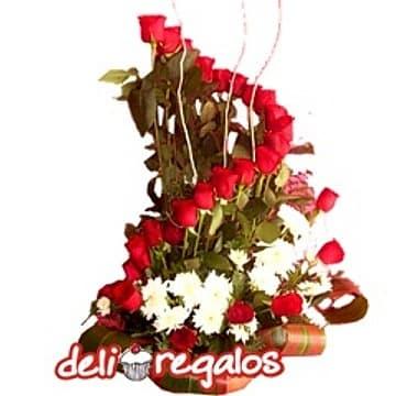 Deliregalos.com - Caminito - Codigo:ARL44 - Detalles: Imponente arreglo floral de 24 rosas importadas, gerberas, flores y follaje de estacion, todo en una base de ceramica.  - - Para mayores informes llamenos al Telf: 225-5120 o 476-0753.
