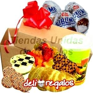 Desayuno de Pascuas - Codigo:EAS10 - Detalles: Caja de regalo conteniendo: Jugo de Frutas, s�ndwich mixto de jam�n y queso en Pan Bimbo Especial,, muffin de vainilla,4 galletas de chispas de chocolate, Ensalada de frutas, tres huevos de pascua a base de chocolate.  incluye tarjeta de dedicatoria y juego de cubiertos.  - - Para mayores informes llamenos al Telf: 225-5120 o 4760-753.