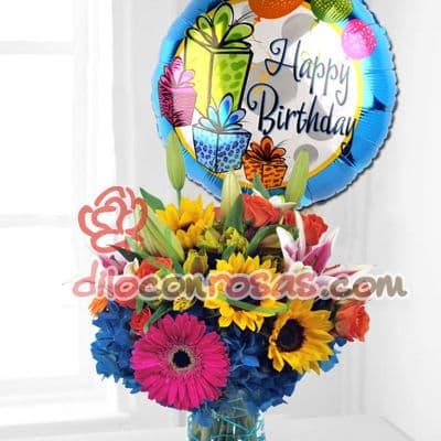 Diloconrosas.com - Arreglo floral en base de ceramica compuesto por girasoles, margaritas, flores y follaje de estacion. Globo grande de 20cm de diametro. El presente incluye una tarjeta de dedicatoria. - Atendemos 24 horas. Llamar al 225-5120 o via Whatsapp: 980-660044