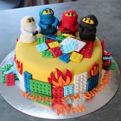 Tortas.com.pe - Torta Lego Ninjago 06 - Codigo:LGT30 - Detalles: keke De Vainilla   ba�ado en manjar y forrado en su totalidad con masa elastica, con las siguientes medidas:  20 cm de diametro, mu�ecos modelados. - - Para mayores informes llamenos al Telf: 225-5120 o 476-0753.
