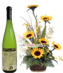 Tortas.com.pe - Vino Tacama Blanco Especial y Arreglo - Codigo:LIC07 - Detalles: Arreglo Floral en base a 6 Girasoles junto a una botella de vino Tacama Blanco edicion Especial. - - Para mayores informes llamenos al Telf: 225-5120 o 476-0753.