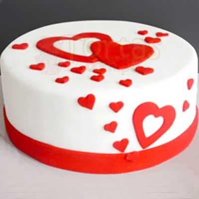 Deliregalos.com - Enamorados 06 - Codigo:NMR06 - Detalles: Deliciosa torta de keke De Vainilla ba�ada con manjar y forrada con masa elastica de Medida: de 20 cm diametro,decoracion en masa elastica, base forrado en papel de aluminio. - - Para mayores informes llamenos al Telf: 225-5120 o 476-0753.