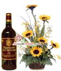 Deliregalos.com - Arreglo Floral y Vino Tinto - Codigo:OFE23 - Detalles: Arreglo Floral en base a 6 Girasoles junto a una botella de vino M�rquez de C�ceres de 750cc. Consultar Disponibilidad de produto antes de Comprar. - - Para mayores informes llamenos al Telf: 225-5120 o 476-0753.
