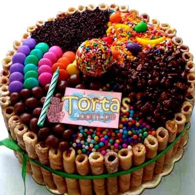 Torta Candy 02 - Codigo:TAA02 - Detalles: Espectacular torta a base de keke ingles bañado con manjar . Contiene dulces segun imagen bastones dulces a los costados y caramelos surtidos en la parte superior. Tamaño de la torta: 15cm de diametro  - - Para mayores informes llamenos al Telf: 225-5120 o 4760-753.