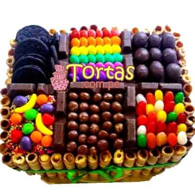 Torta Candy 05 - Codigo:TAA05 - Detalles: Espectacular torta a base de keke ingles bañado con manjar . Contiene dulces segun imagen bastones dulces a los costados y caramelos surtidos en la parte superior. Tamaño de la torta: 20cm x 30cm  - - Para mayores informes llamenos al Telf: 225-5120 o 4760-753.