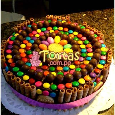 Torta Candy 07 - Codigo:TAA07 - Detalles: Espectacular torta a base de keke ingles bañado con manjar . Contiene dulces segun imagen bastones dulces a los costados y caramelos surtidos en la parte superior. Tamaño de la torta: 25cm de diametro  - - Para mayores informes llamenos al Telf: 225-5120 o 4760-753.