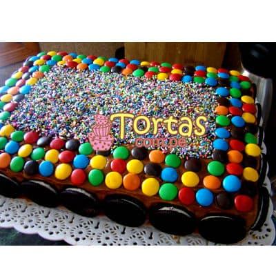 Torta Candy 10 - Codigo:TAA10 - Detalles: Espectacular torta a base de keke ingles bañado con manjar . Contiene dulces segun imagen bastones dulces a los costados y caramelos surtidos en la parte superior. Tamaño de la torta: 20cm x 30cm.  - - Para mayores informes llamenos al Telf: 225-5120 o 4760-753.