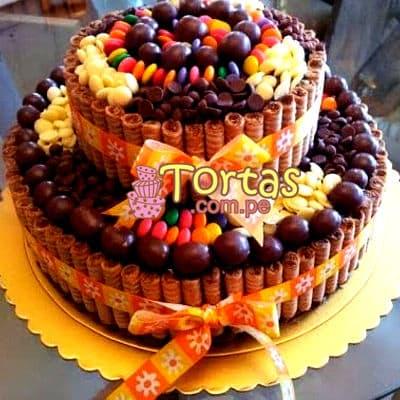 Torta Candy 14 - Codigo:TAA14 - Detalles: Espectacular torta a base de keke ingles bañado con manjar . Contiene dulces segun imagen bastones dulces a los costados y caramelos surtidos en la parte superior. Tamaño de la torta: 25cm de diametro. 15 cm de diametro el segundo piso.  - - Para mayores informes llamenos al Telf: 225-5120 o 4760-753.