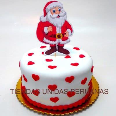 Torta Papa Noel - Codigo:TNA06 - Detalles: Keke ingles bañado con manjar blanco y forrado con masa elastica segun imagen. Tamaño: 20cm diametro. Incluye Papa Noel en azucar - - Para mayores informes llamenos al Telf: 225-5120 o 4760-753.