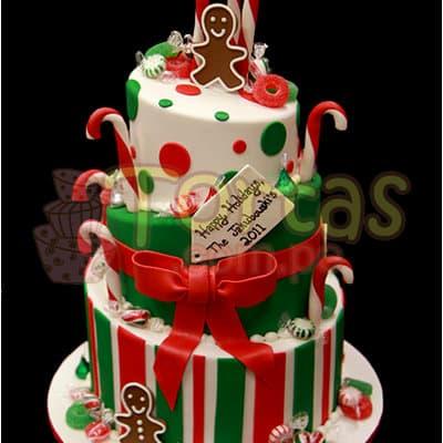 Diloconrosas.com - Gran Torta Navidad 20 - Codigo:TNA20 - Detalles: Keke De Vainilla ba�ado con manjar blanco y decorado enteramente en masa el�stica, primer piso de 25cm de di�metro, segundo de 20 y tercero de 15cm incluye decoraci�n de mo�os y detalles de la imagen.  - - Para mayores informes llamenos al Telf: 225-5120 o 476-0753.
