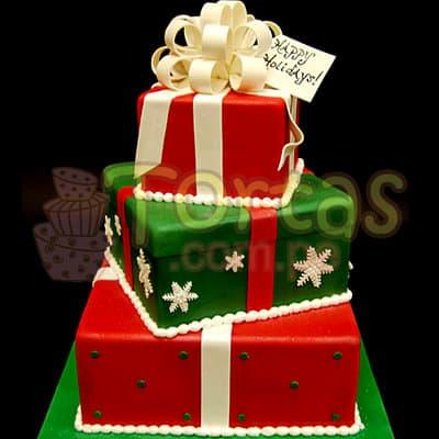Gran Navidad 21 - Codigo:TNA21 - Detalles: Keke ingles bañado con manjar blanco y decorado enteramente en masa elástica, primer piso de 35cm x 35cm,  segundo de 20cm x 20cm  y tercero de 15cm x 15cm incluye decoración de moños y detalles de la imagen. Solicitar con 96 horas utiles de anticipacion. - - Para mayores informes llamenos al Telf: 225-5120 o 4760-753.