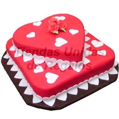 Diloconrosas.com - Torta Coraz�n dos Niveles - Codigo:TRR28 - Detalles: Deliciosa Torta de Cake De Vainilla rellenacon fruta confitada en forma de coraz�n cubierta con Masa el�stica, y decorada con corazones blancos y una Rosa hecha a mano, la torta viene en dos niveles, primer nivel de 25cm x 25cm y el segundo nivel(coraz�n) 19cm x 20cm. Rinde: 40 porciones, incluye tarjeta de dedicatoria.   - - Para mayores informes llamenos al Telf: 225-5120 o 476-0753.