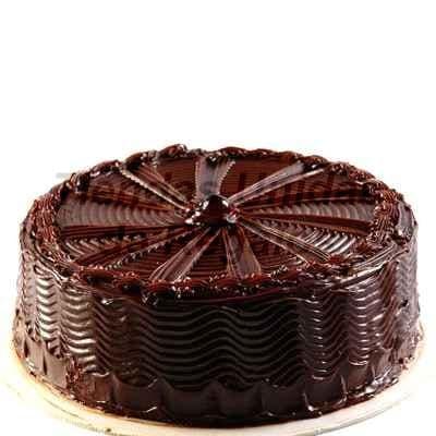 I-quiero.com - Torta Chocolate  03 - Codigo:WCH03 - Detalles: Delicioso Queque de Chocolate relleno con crema chantilly ba�ado por encima y por los lados con chocolate.Mide 20cm de diametro.  Rinde 20 porciones.  - - Para mayores informes llamenos al Telf: 225-5120 o 476-0753.