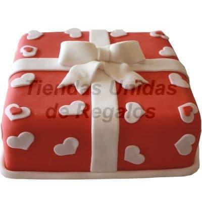 Torta Gran regalo - Codigo:WDA10 - Detalles: Delicioso queque ingles relleno exquisita fruta confitada y pasas y decorado finamente con masa elastica en forma de cajita de regalo y corazones de 25 x 25. - - Para mayores informes llamenos al Telf: 225-5120 o 4760-753.