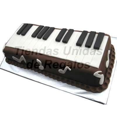 Diloconrosas.com - Torta Piano - Codigo:TRR23 - Detalles: Delicioso queque De Vainilla relleno con exquisita fruta confitada, el decorado es a base de masa el�stica. La torta tiene el modelo de piano. Medidas: 10cm x 20cm. - - Para mayores informes llamenos al Telf: 225-5120 o 476-0753.